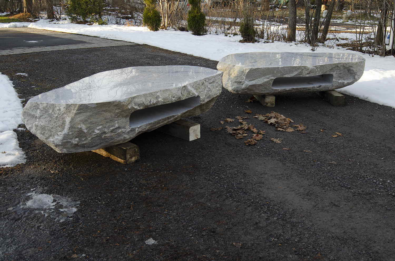 Two Polished stone boulder coffee table